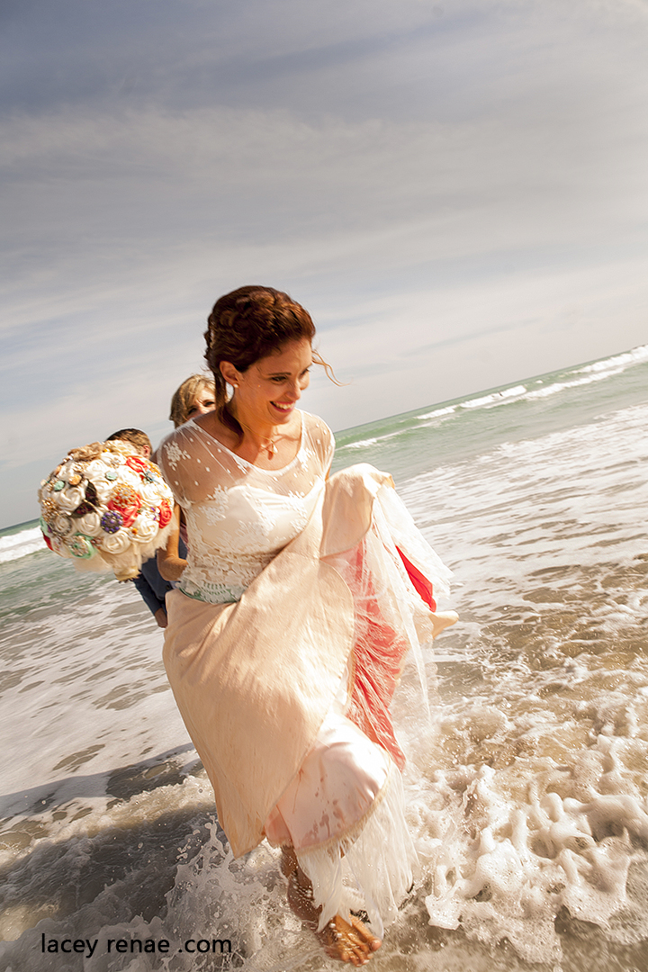 bride walking in the ocean
