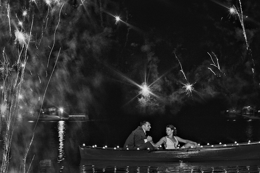 I admit.. this photo would have been impossible to take, so I made it. I don't often wish I'd worked with someone else but this time I did— there was a lot going on, a beautiful couple, sparklers, boats, fireworks, dogs, kids, tents, rain. A pig roast… .