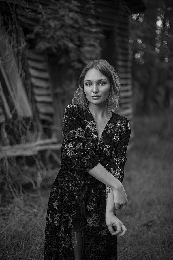 Beautiful woman by barn photo