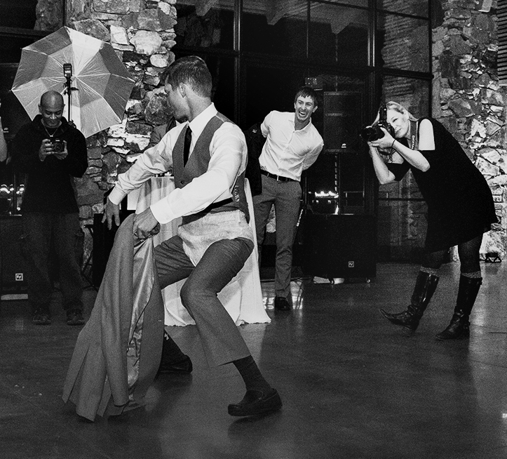 And thanks to the second shooter for this image— the best man apparently lost a bet of some kind, not only performing in a diaper for the duration of Stroke It (ooh man) but giving a bit of a lap dance to the beautiful bride. Jean was in hysterics, and as you can see so was her groom.