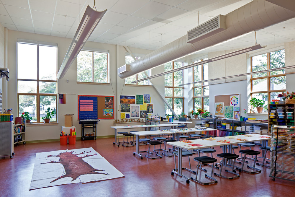 North light in the art room is supplied by high ceilings and floor-to-ceiling windows.