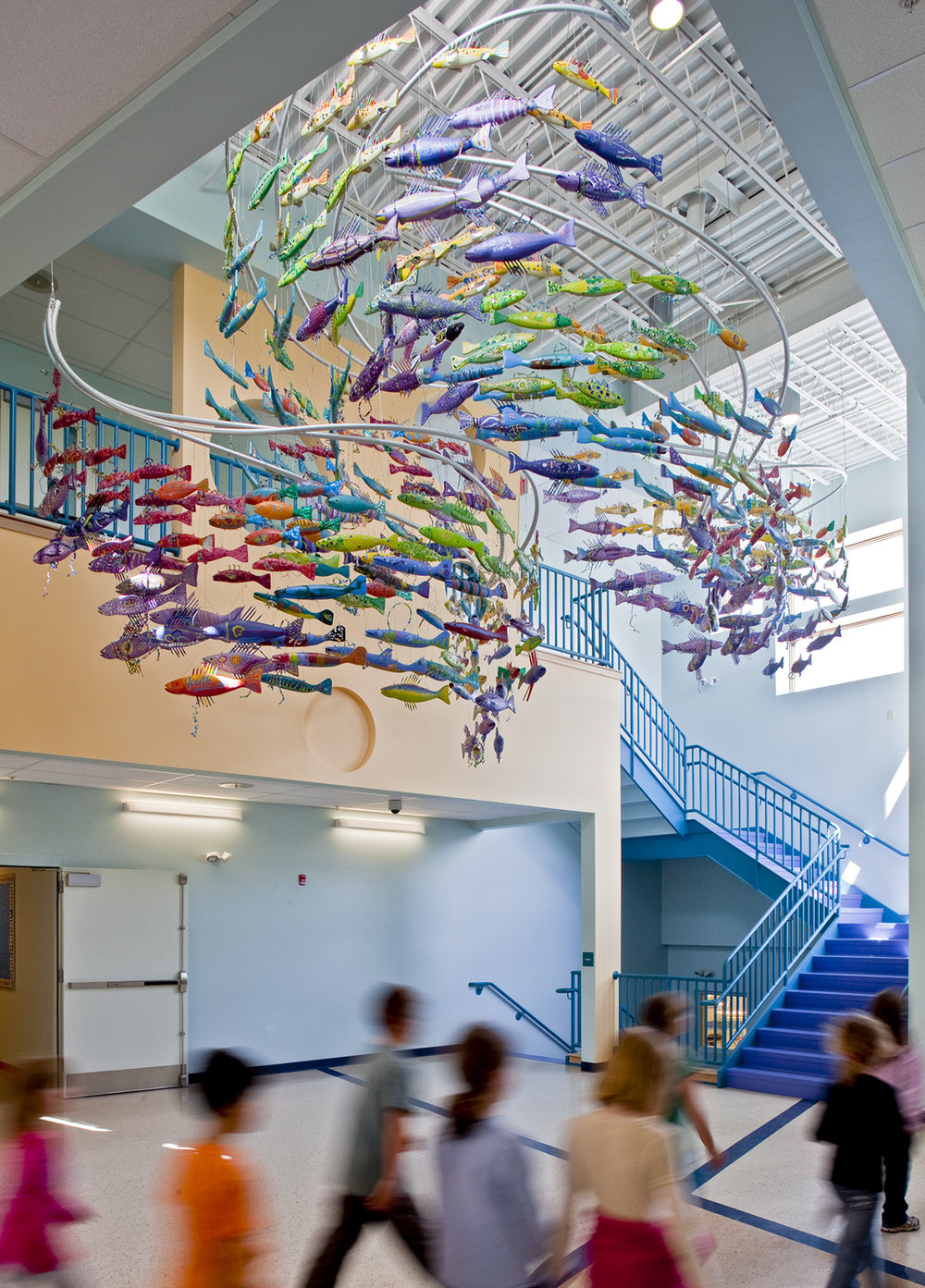 The lobby was designed around this FishES mobile, a project led by the Youth Arts organization in Camden. Every student in the school made a fish that swims overhead as you enter the building.