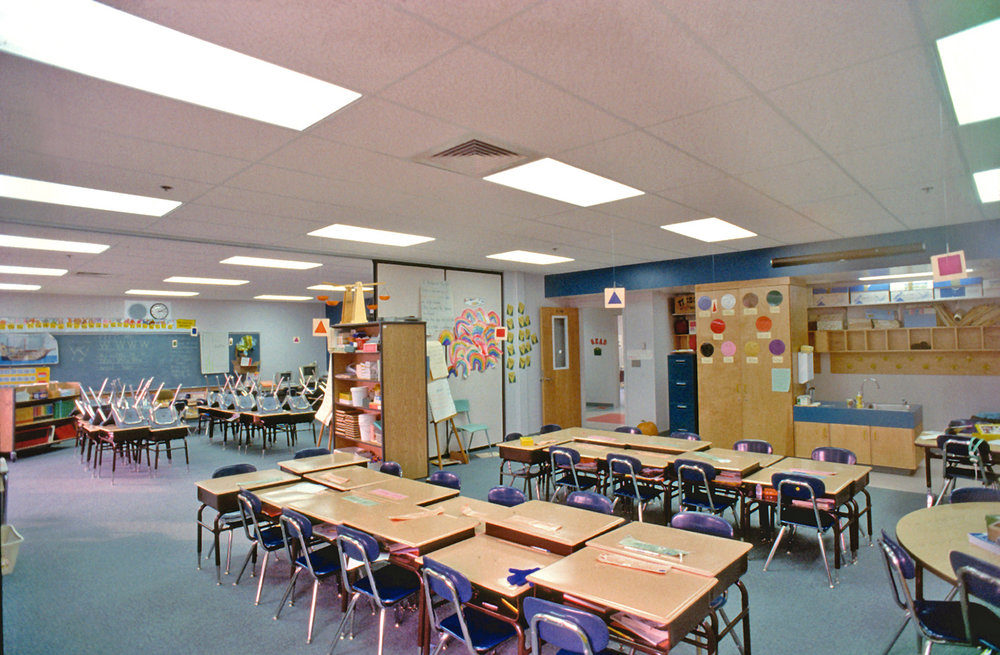 Operable partitions between classrooms encourage team teaching while providing flexible levels of acoustic privacy.
