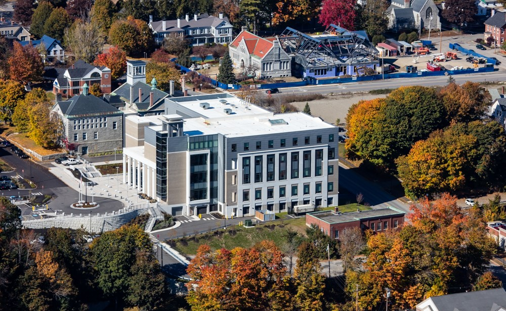 In spite of its imposing size, the new courthouse sits lower on its sloping site than the Kennebec County Courthouse, the Kennebec County Jail (out of the picture, to the left), and the Augusta Public Library (red roof), so it does not dominate the surrounding cluster of historic buildings.