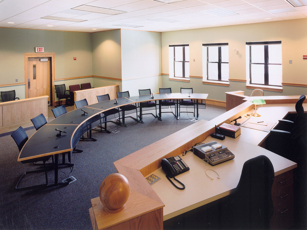 The design of the family courtroom de-emphasizes division, with all parties in an arc at equal distance from the bench.