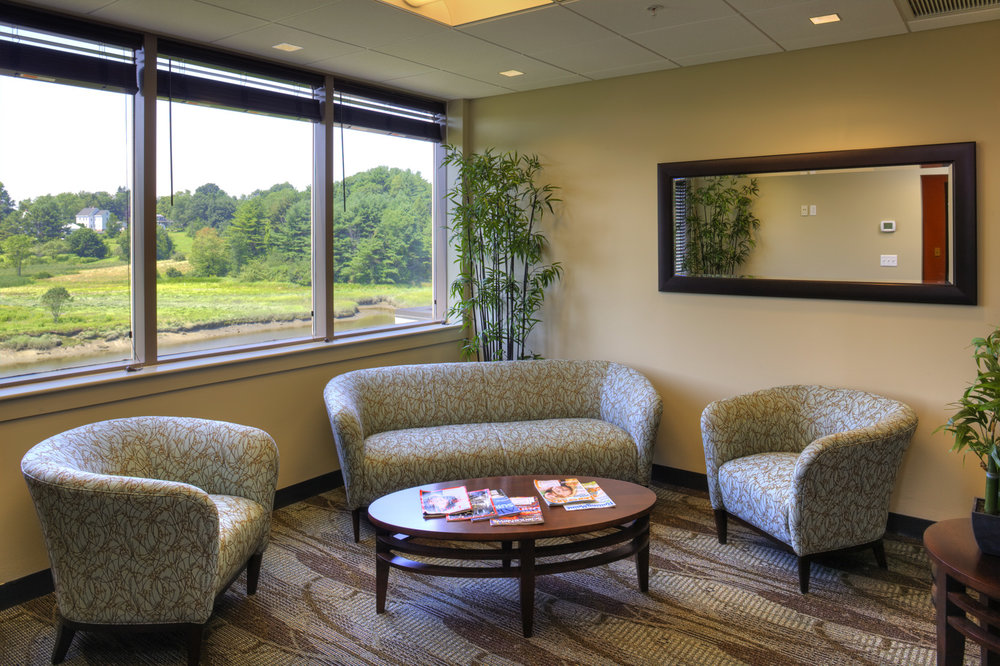 The Simply Radiant waiting room is an attractive seating area with views of the Stroudwater River.