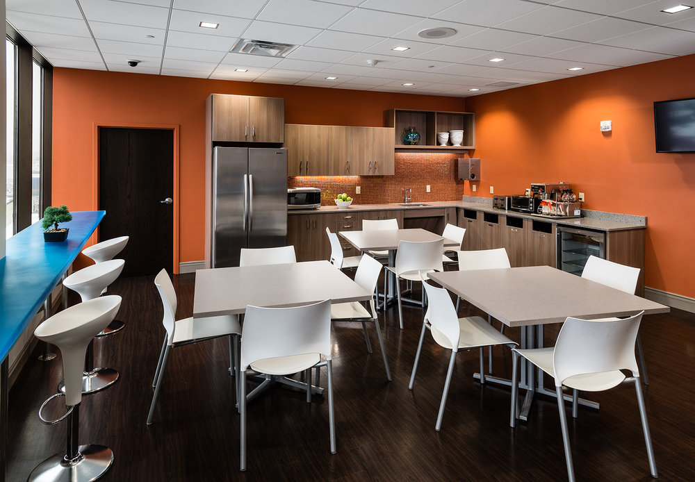 The inviting break room on the 6th floor includes a coffee bar with dramatic views toward the waterfront.