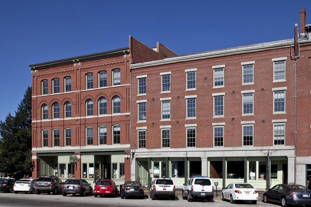 The historic Nathan Winslow Block fronts on Portland's busy Commercial Street and houses retail, a restaurant, and offices on the floors above.