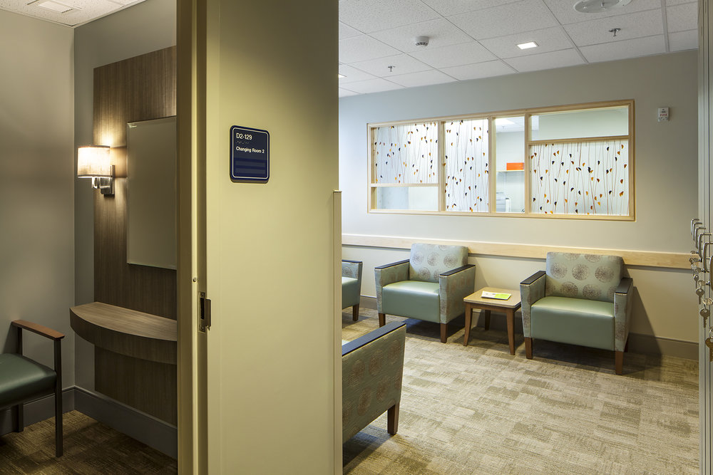 Private changing rooms lead directly to the gowned waiting area.