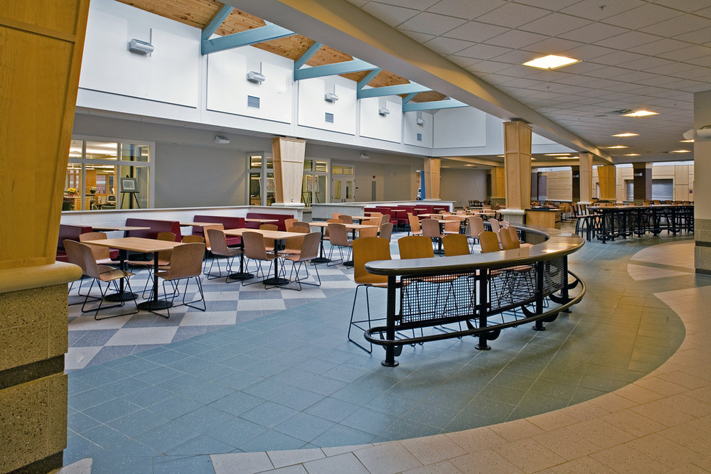 The open food court, the heart of school, is in constant use as a meeting place and study hall.
