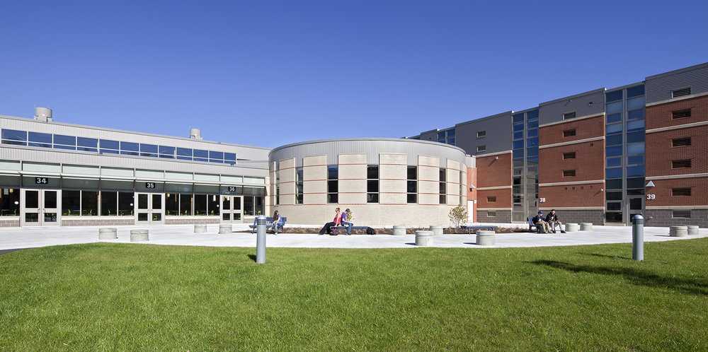The existing 3-story classroom wing on the right received a deep energy retrofit to match the energy performance of the new wing on the left.