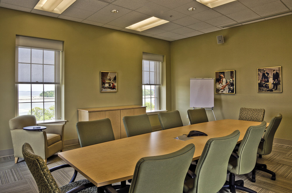 The conference center includes conference and meeting rooms of several sizes, with a small kitchen and dining spaces.
