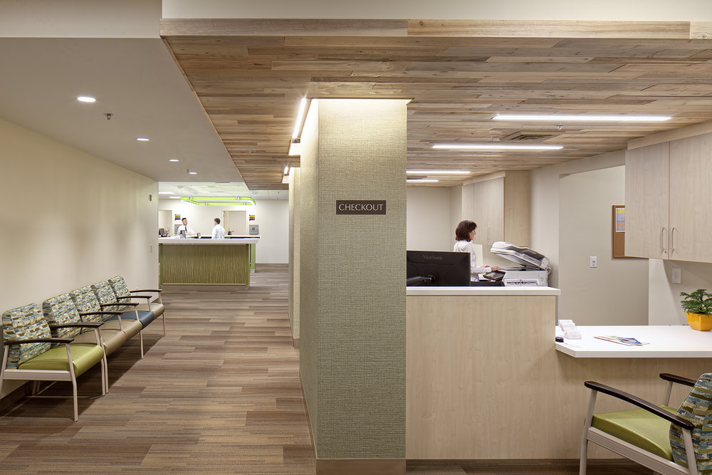 The introduction of warm tones from reclaimed Maine timber creates a comfortable setting for staff and patients.