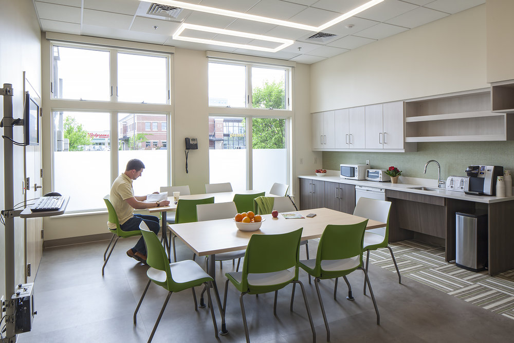 With quiet colors, interesting textures, and a splash of color, the kitchen/break/meeting room is a great place to decompress.