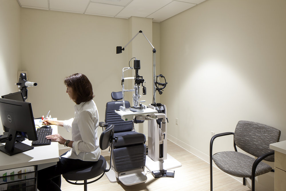 The exam rooms are purposely devoid of color in order to minimize afterimage adjustments that can slow the efficiency of the exam.