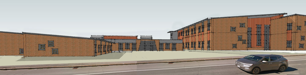 In progress—Low sloped roofs and red brick help the new school fit with neighborhood architecture.