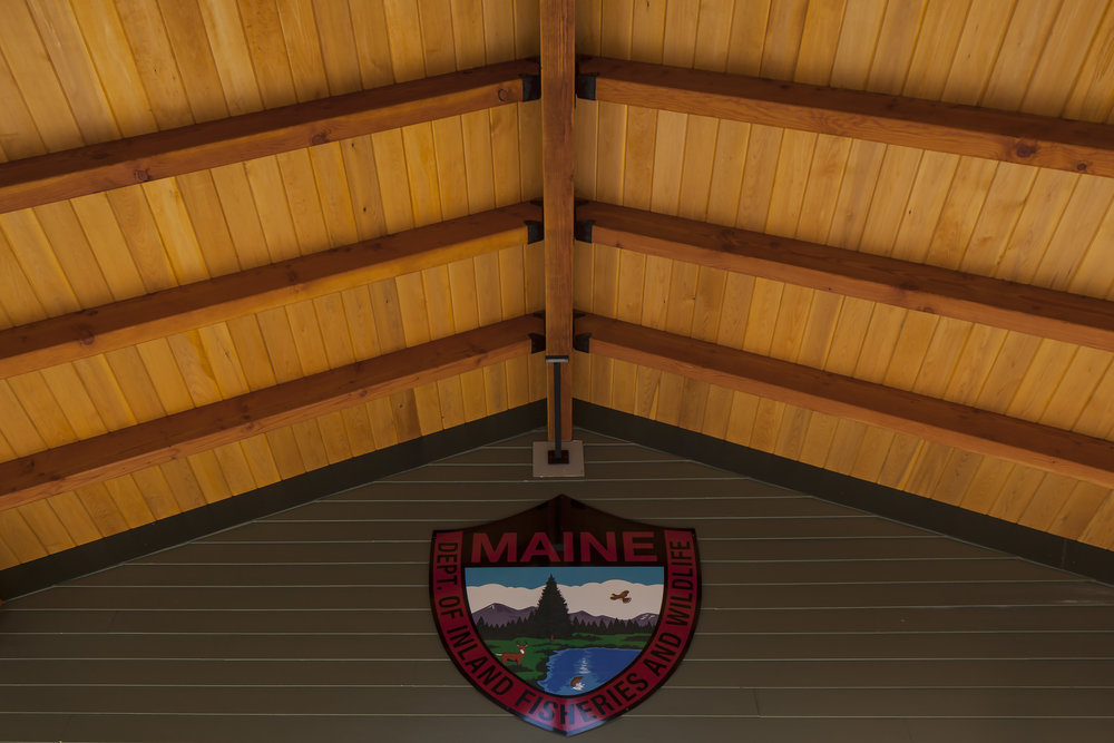 Douglas fir and eastern white cedar were used in the main entry wood canopy detail.