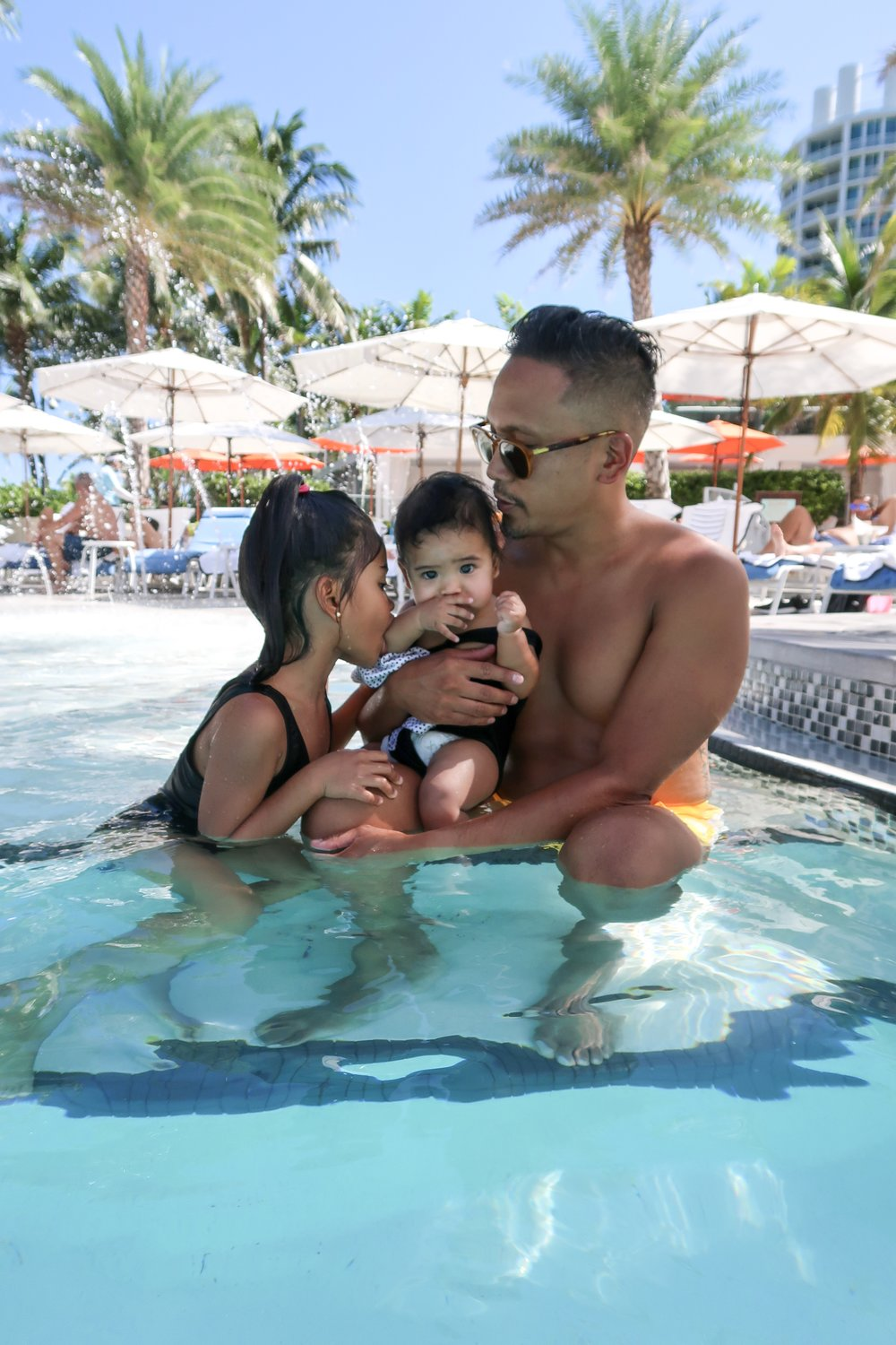 The hubby and the girls cooling down after chilling in the cabana at SOAK.