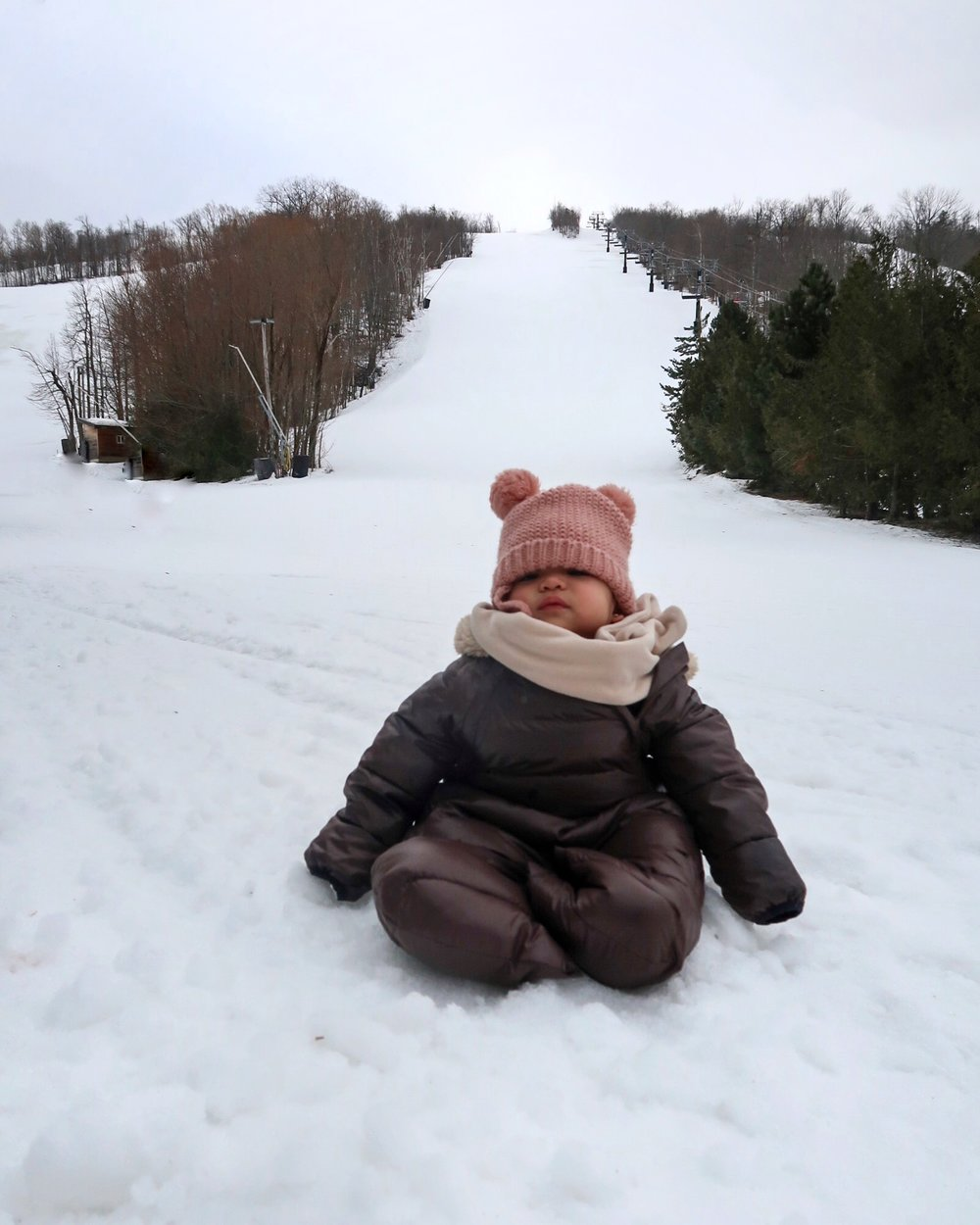 Baby Noa waiting for her big sister at the bottom of the hill!