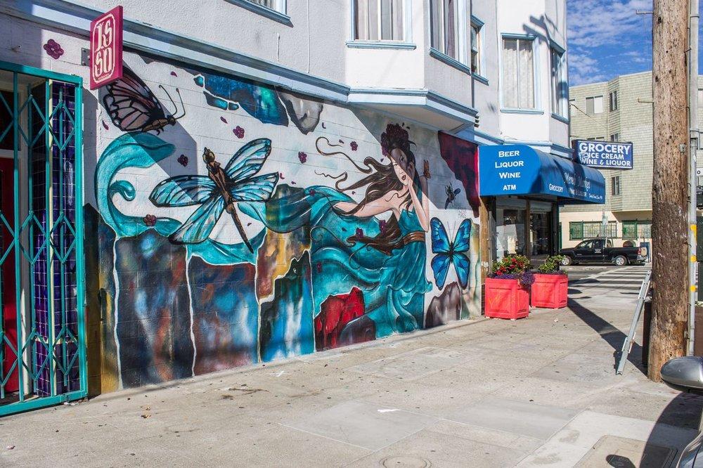 23 Alynn & Lady Mags Mural on corner store.jpg