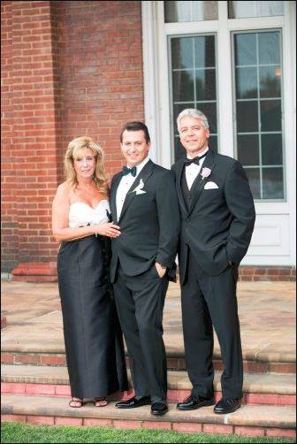 With Mom and Dad at our wedding