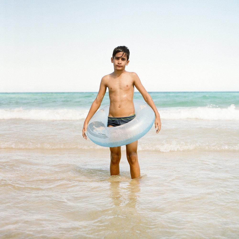 Cuba-boy-with-float-ocean-santa-maria-playa-havana-christina-arza.jpg