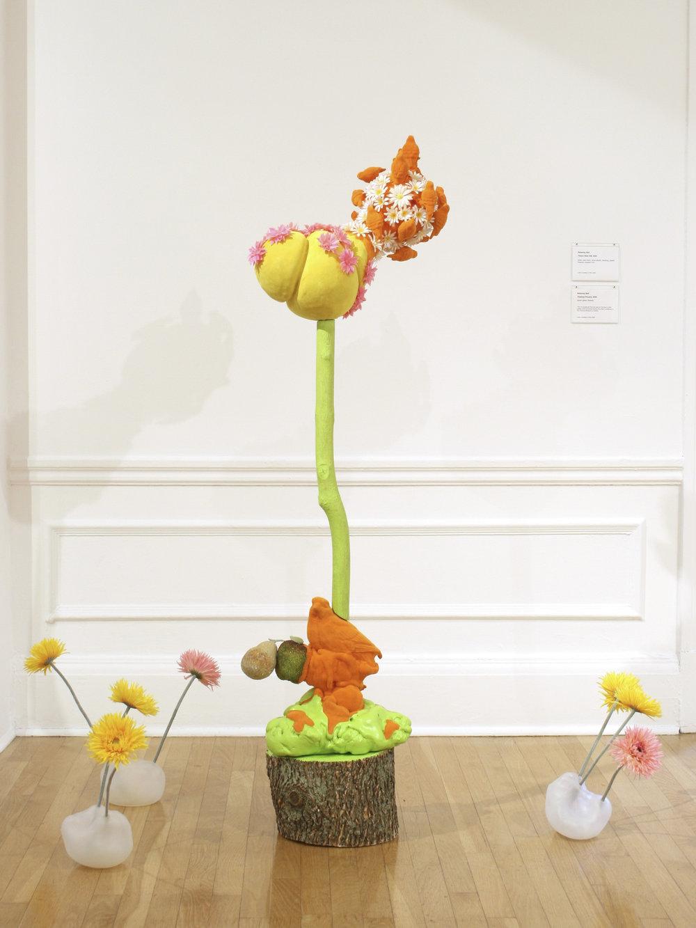 Flower Blob #82  2009 cast foam with plastic, flocking, tree trunk, wood 60 x 22 x 16 inches