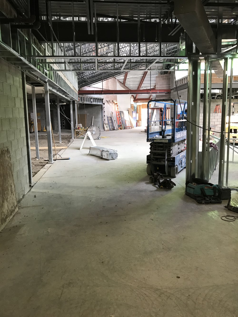 Looking west towards our Learning Commons (on the left), commercial kitchen/eatery (on the right), and our student gathering section in between the two.