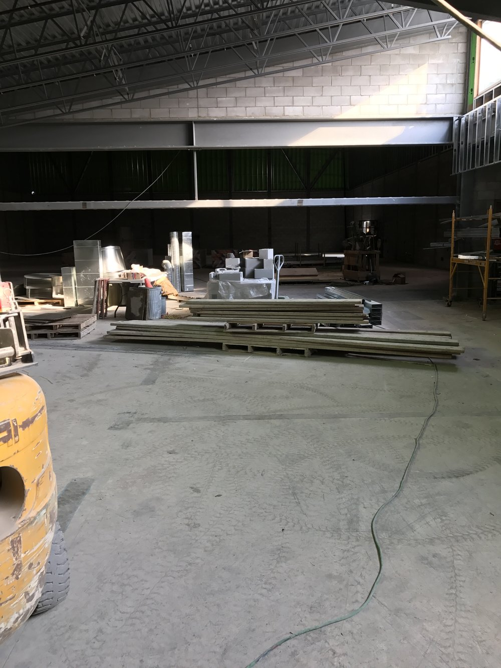 Looking north into our new gym! The metal beam will be removed and sliding glass doors will be across this entrance. Pretty cool!