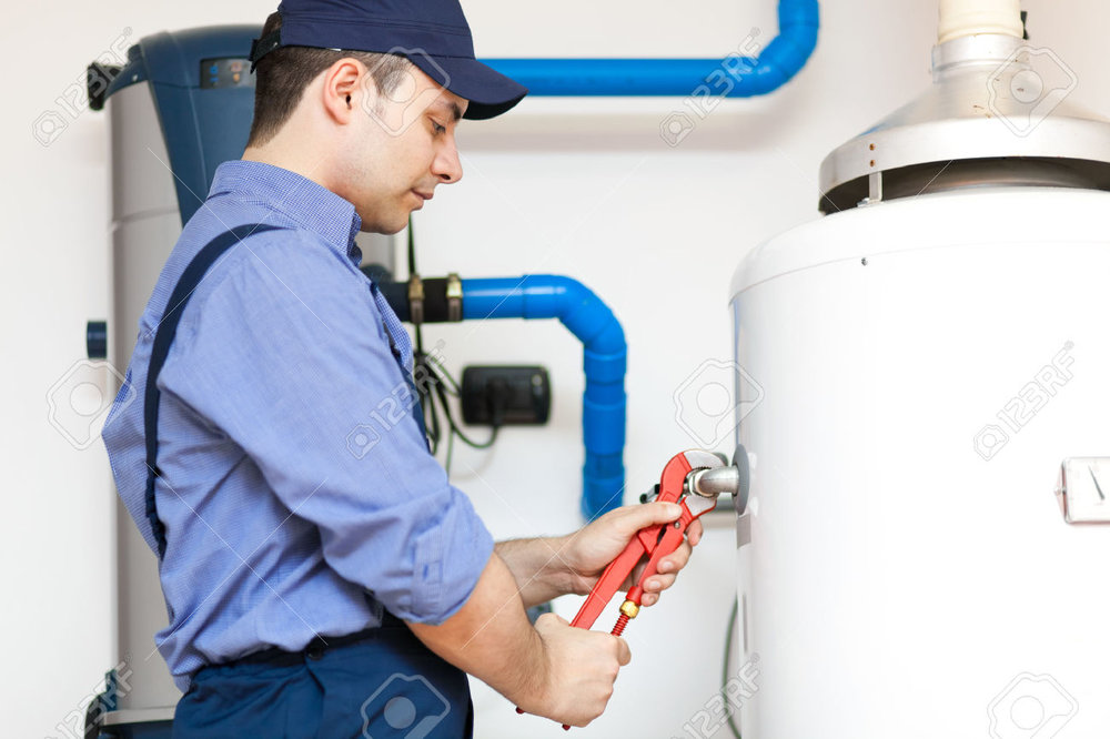 35517401-Plumber-repairing-an-hot-water-heater-Stock-Photo.jpg