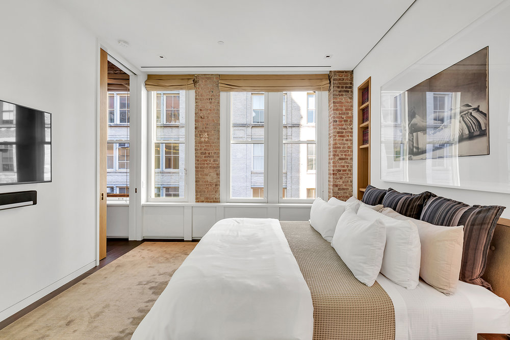 Take a Look Inside This Pre-War Loft With Restored Wood Beams Overlooking Crosby Street in SoHo