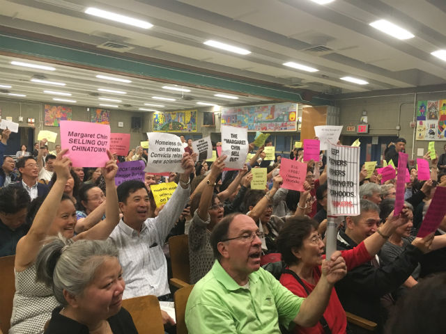 Chinatown residents jeered at city officials.
