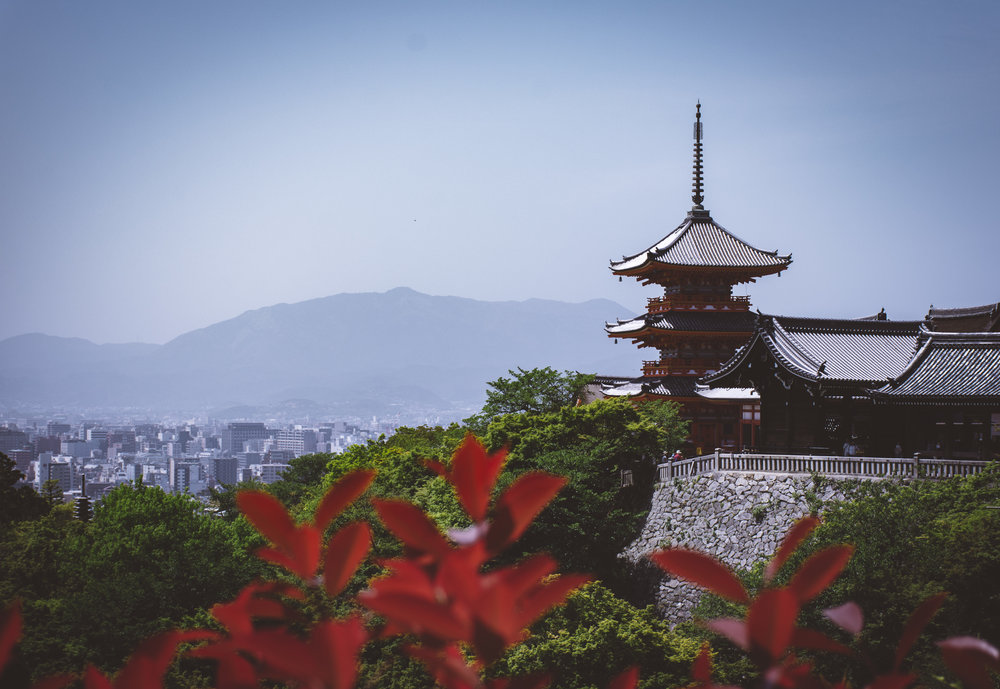 temple with a view - Kiyomizu-dera looks out unto the sprawling modern Kyoto just beneath its feet.
