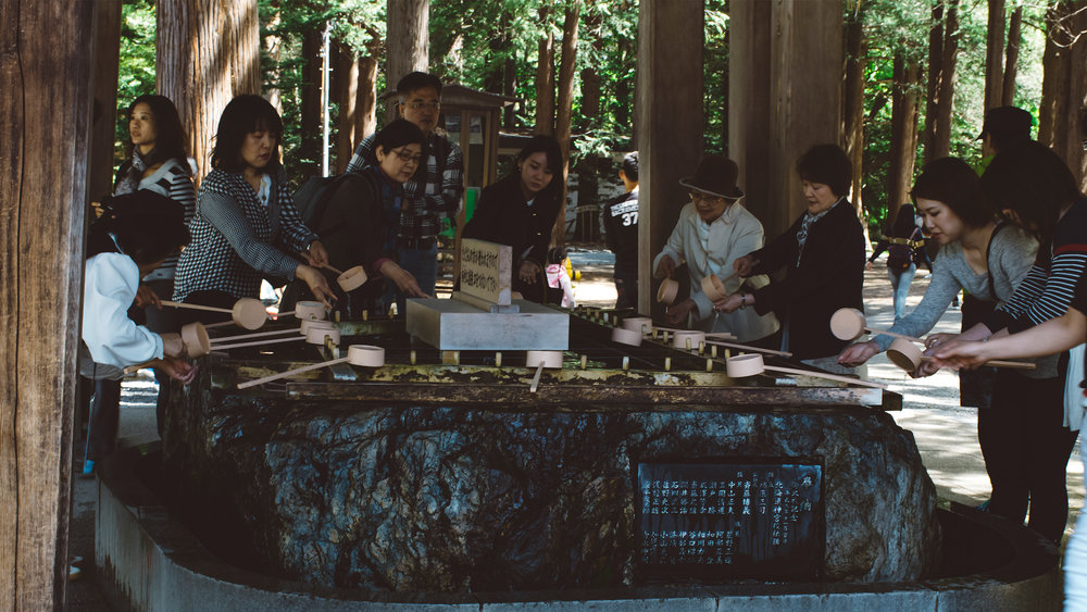 Hokkaido Shrine. Sapporo. Visitors performing a Shinto purification.