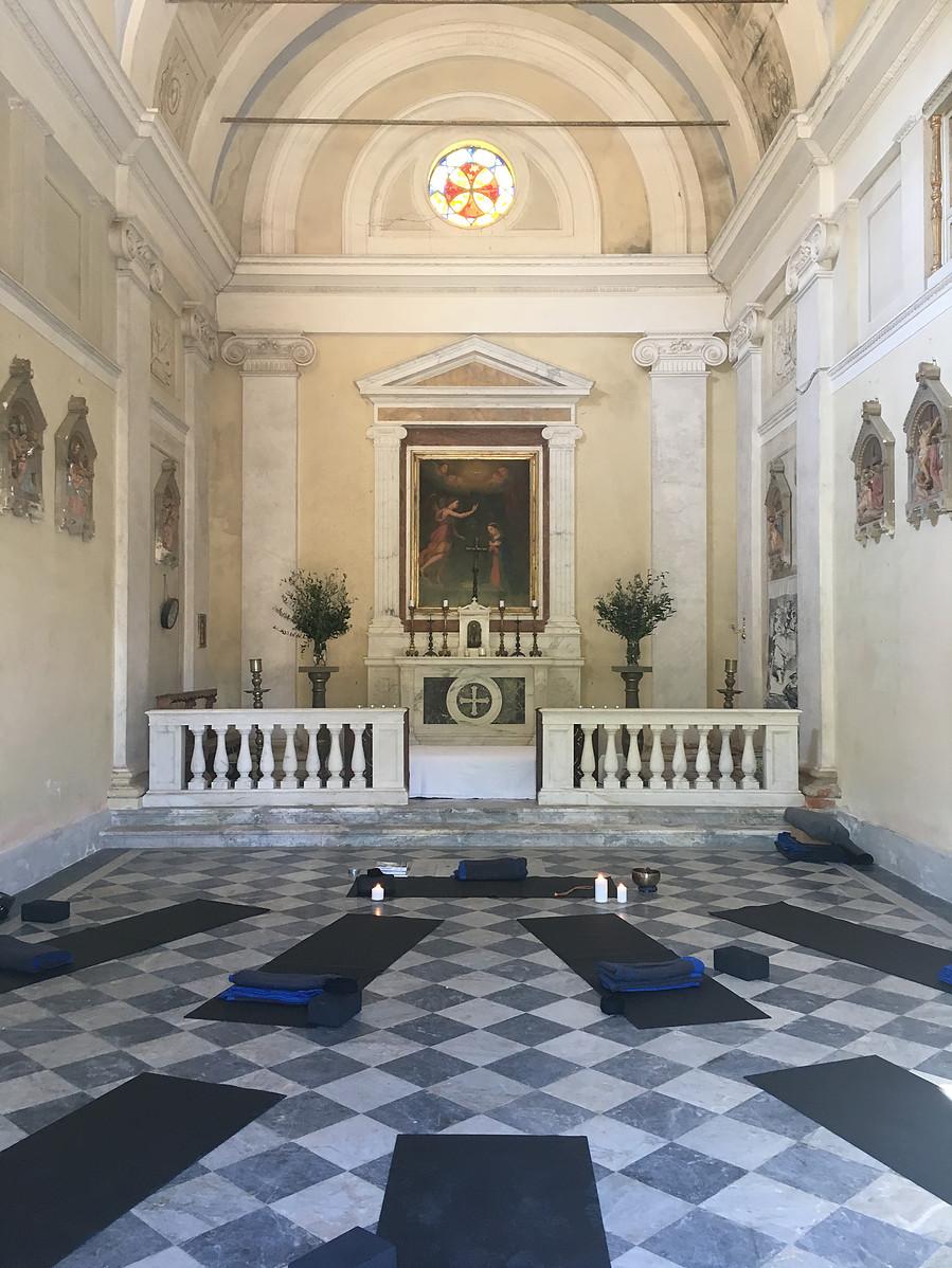 Yoga mats around an alter in Italian Villa