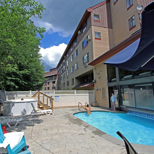 Outdoor pool and hot tub in Waterville Valley, New Hampshire