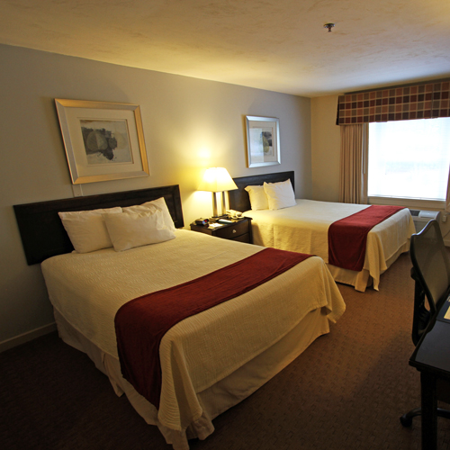 Clean bedroom in Waterville Valley hotel.