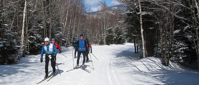 Waterville Valley's Adventure Center maintains more than 70 km of groomed trails for skate and classic cross-country skiing, plus snowshoeing and fat biking, with terrain for every ability level.