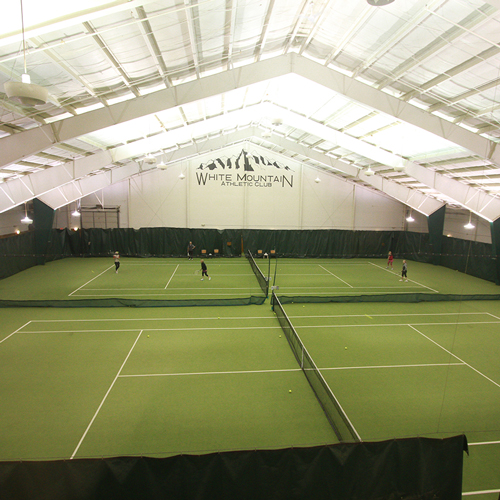 No not in the snow, but on one of two heated, indoor tennis courts which offer year round tennis fun and instruction