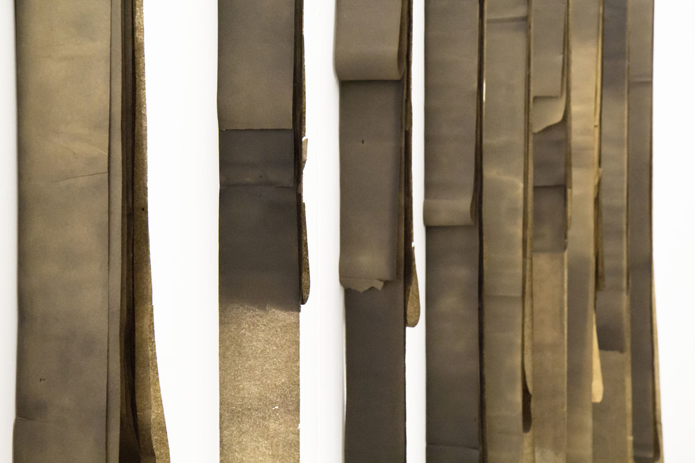 Vladislav Markov  xC, 2017 (detail) tar, gasoline on vintage toilet paper dimensions variable to installation (VM1) installation view Cornell University, courtesy the artist