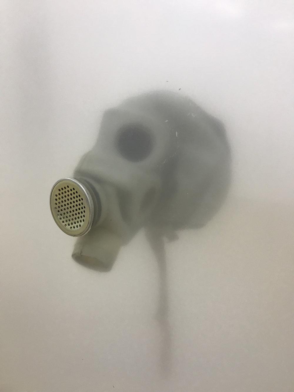 Vladislav Markov  Untitled , 2018 (detail) library shelves, Plexiglas, polyurethane engine cast, gas mask, fog machine,  plastic hose, self-adhesive carpet protector film 84 x 84 x 24 inches (213 x 213 x 61 cm) (VM3)