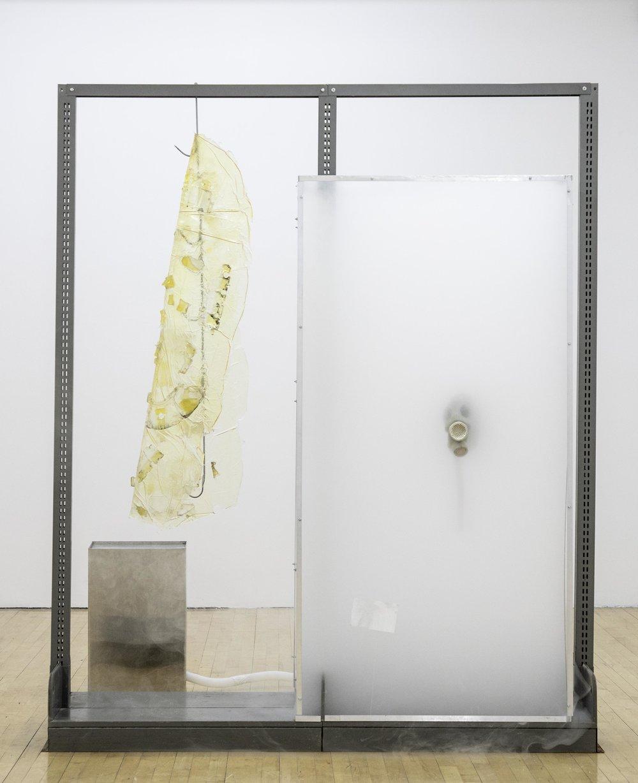 Vladislav Markov  Untitled , 2018 library shelves, Plexiglas, polyurethane engine cast, gas mask, fog machine, plastic hose, self-adhesive carpet protector film 84 x 84 x 24 inches (213 x 213 x 61 cm) (VM3)