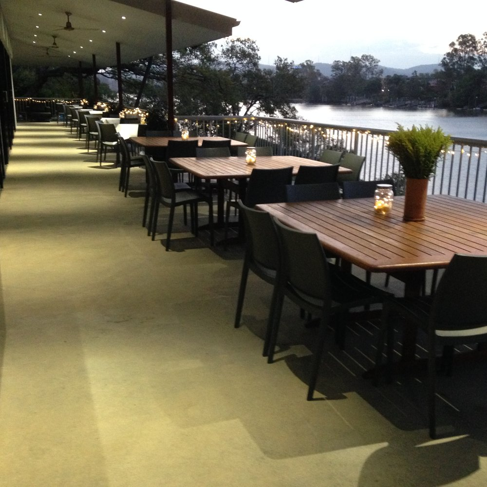 Or drinks and nibbles on our balcony - The balcony area offers a unique aspect.  Where else in Brisbane do you have such a wonderful view of the St Lucia reach of the river - and so pretty at night with the soft glow of the house lighting across the river. The balcony area comfortably fits  over 100 guests. The furniture too can be moved to suit your own decor design.