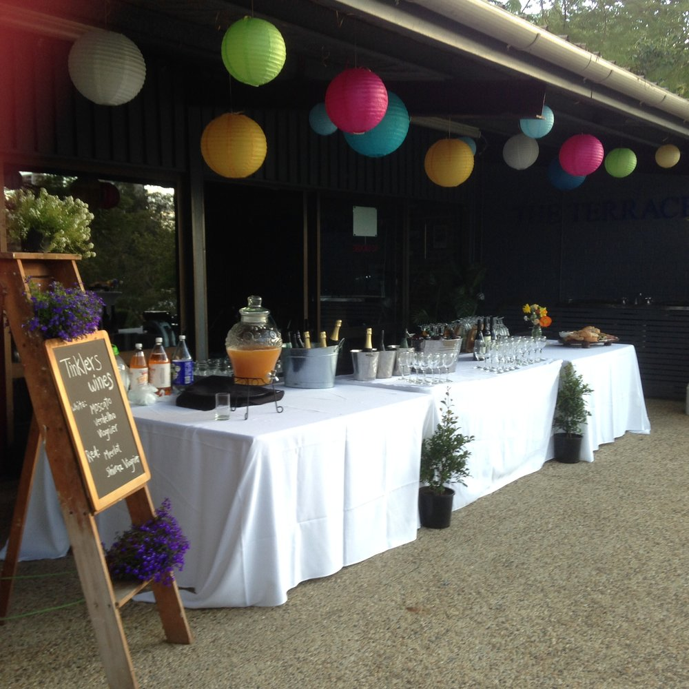What do your guests do while you are getting your wedding photos?  - Drinks from our terrace bar at Toowong Rowing Club. Nibbles too,  either served by your caterer or on antipasto platters on our dry bars on the lawn. A full selection of drinks is available from our downstairs bar. Decor for the bar is also optional and again you are free to add your own personal touches.