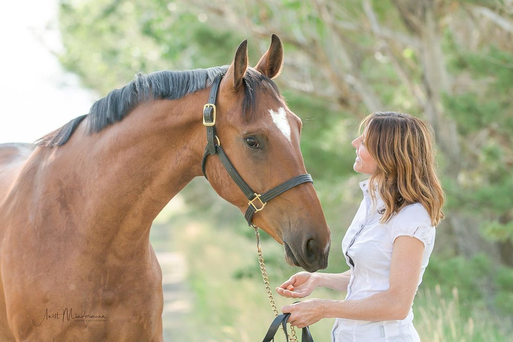Girl looking at Horse, close up during photo shoot