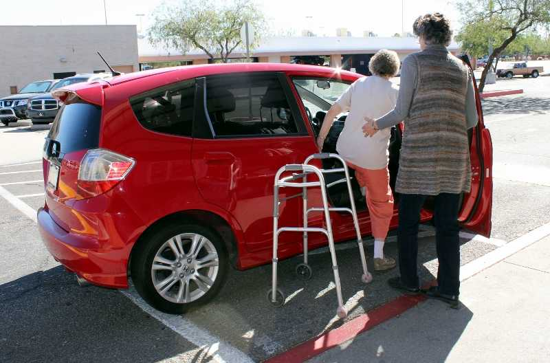 senior transportation services roanoke va - companion home care - woman getting in car