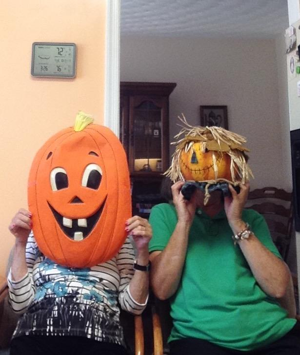 senior home care client wearing pumpkin halloween costumes with home health care companion in roanoke va.jpg