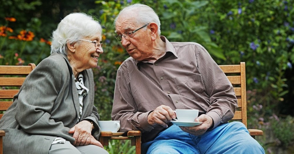 senior elderly couple enjoying tea outside in summer - companion home care inc roanoke va.JPG