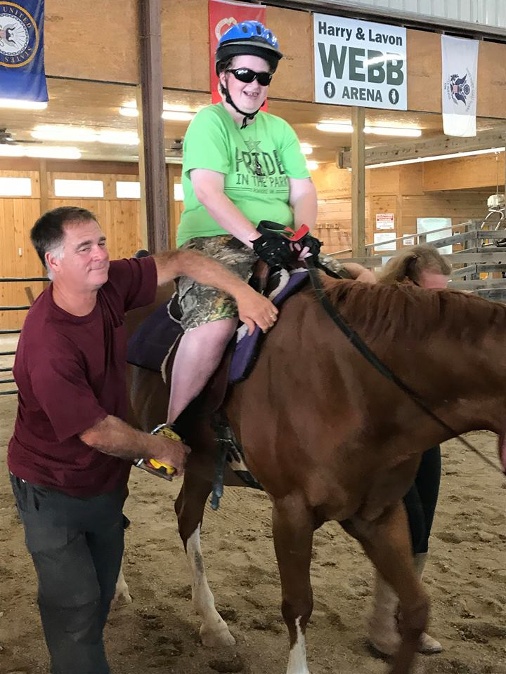 Companion Home Care Inc client Pattrick Ryan posing on horseback at Healing Strides of VA