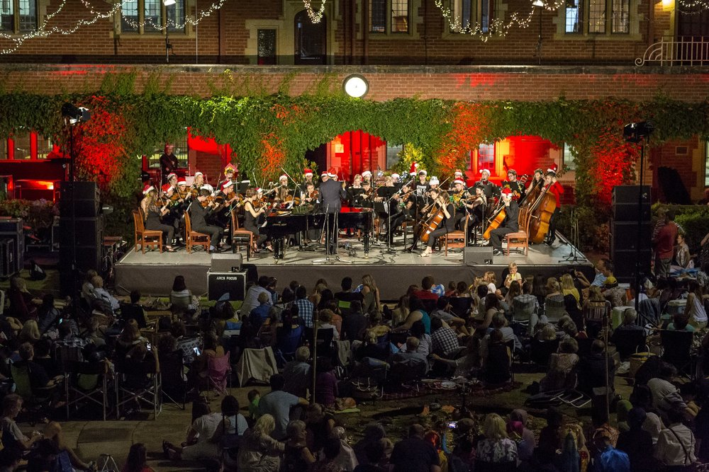 21/12/2015: First Performance of a Full Symphonic Orchestra    Christmas in the Quad  sees the first performance of a full symphonic orchestra at the College, and the first performance of a large ensemble in the open air.